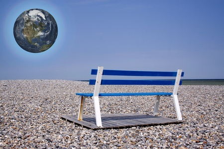 rise above: Planet earth rise above Beach-chair on flintstone along the coast Stock Photo