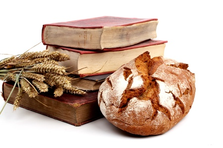 bakery products: Pile of old cookingbooks and fresh baked bread