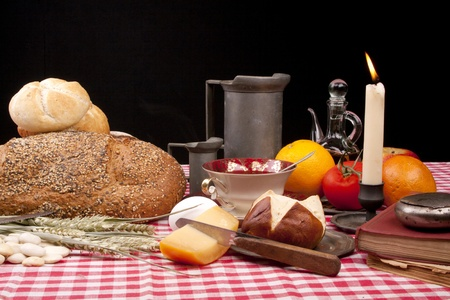 breadloaf: Old fashioned lunch wtih bread and buns on a table against a black background Stock Photo