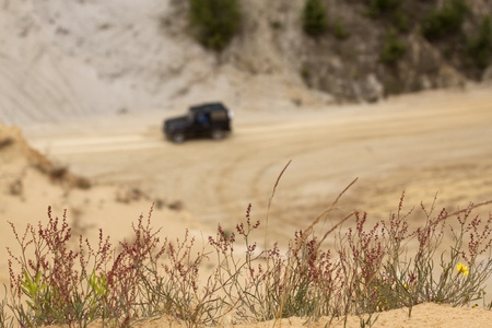 four wheel: four wheel cars driving in a sand pit Stock Photo