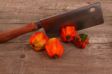 Chili peppers on an rustic wooden table photo