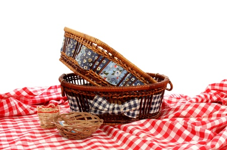 Baskets on a table cover over white
