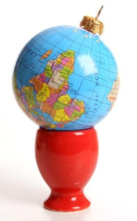 egg cup: Globeas a Christmas ball  in an egg cup