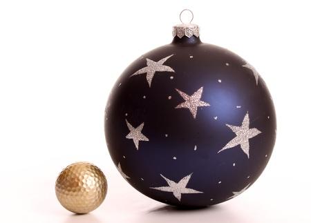 christmas golf: Golden golf ball and a Christmas baulb Stock Photo