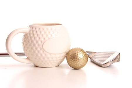 christmas golf: Golden golf ball and club laying next to a golf cup Stock Photo