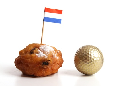 An Oliebol is typical Dutch and is only baked during te days between Christmas and New Year  photo
