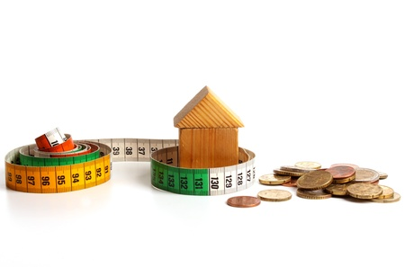 house prices: House  with measuring tape expressing the raise of prices