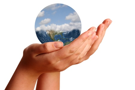 Young womans hand showing the world photo