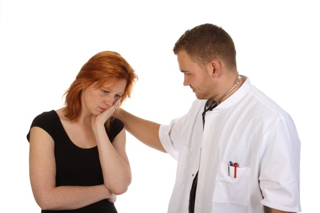 Doctor examining a patient against a white background Stock Photo - 12429369