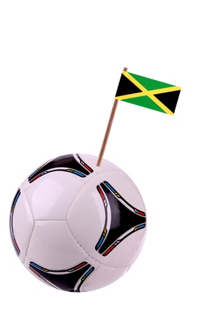 Soccerball or football decorated with a small national flag on a toothstick photo