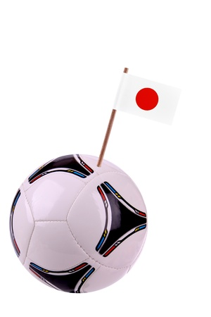 Soccerball or football decorated with a small national flag on a toothstick Stock Photo - 13274508