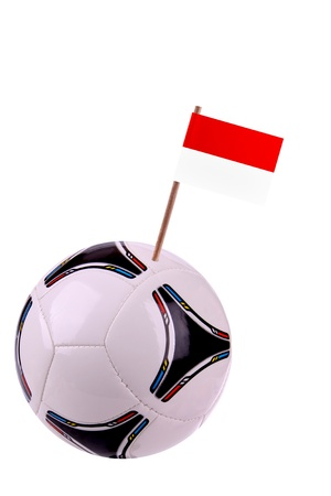 Soccerball or football decorated with a small national flag on a toothstick Stock Photo - 13274507