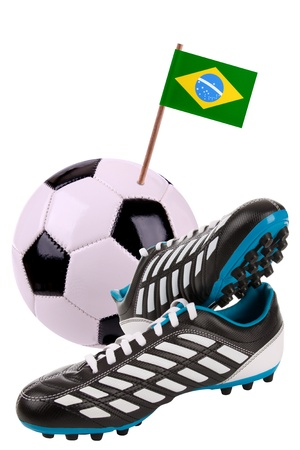 Pair of cleats or football boots with a small flag of Brazil photo