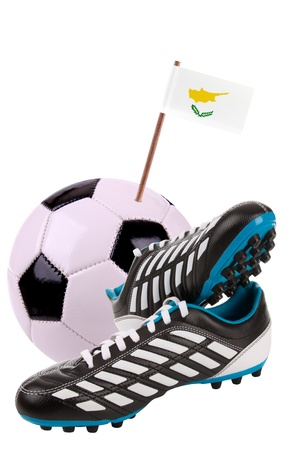 Pair of cleats or football boots with a small flag of Cyprus Stock Photo - 13348350