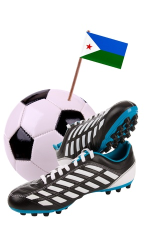 Pair of cleats or football boots with a small flag of Djibouti photo