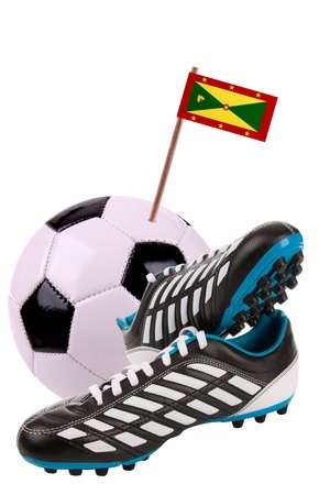 cleats: Pair of cleats or football boots with a small flag of Grenada