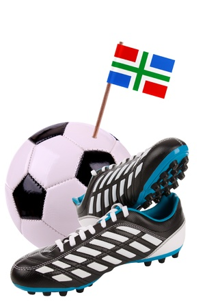 cleats: Pair of cleats or football boots with a small flag of Groningen Stock Photo