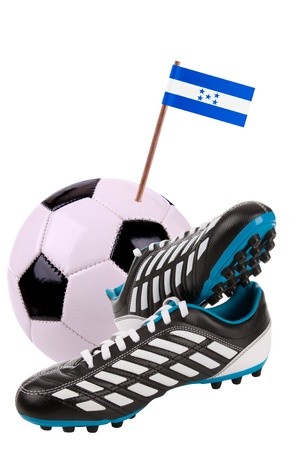 cleats: Pair of cleats or football boots with a small flag of Honduras Stock Photo
