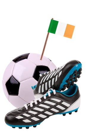 cleats: Pair of cleats or football boots with a small flag of Ireland
