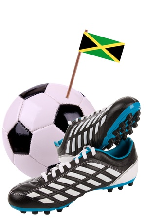 Pair of cleats or football boots with a small flag of Jamaica photo