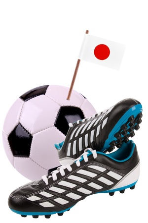 cleat: Pair of cleats or football boots with a small flag of Japan Stock Photo