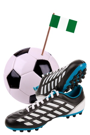 Pair of cleats or football boots with a small flag of Nigeria Stock Photo - 13348459