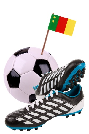 Pair of cleats or football boots with a small flag of Old Cameroon photo