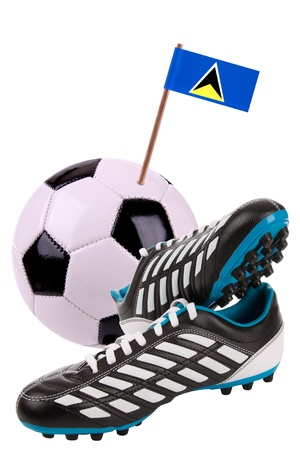 cleats: Pair of cleats or football boots with a small flag of St. Lucia