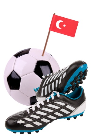 Pair of cleats or football boots with a small flag of Turkey photo