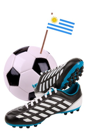 cleat: Pair of cleats or football boots with a small flag of Uruguay Stock Photo