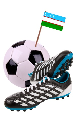 Pair of cleats or football boots with a small flag of Uzbekistan Stock Photo - 13348563