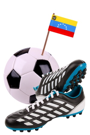 Pair of cleats or football boots with a small flag of Venezuela photo
