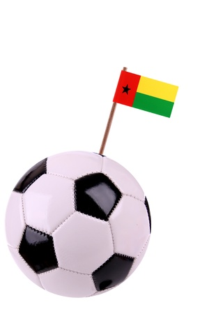 guinea bissau: Soccerball or football decorated with a small national flag on a toothstick
