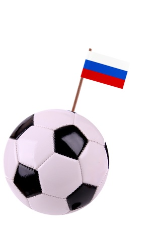 Soccerball or football decorated with a small national flag on a toothstick Stock Photo - 13498290