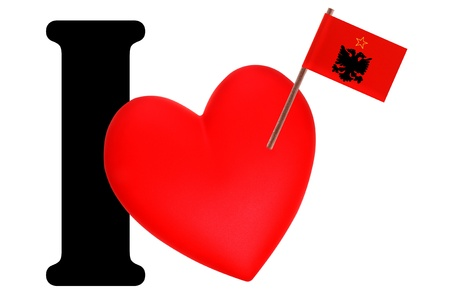 Small flag on a red heart and the word I to express love for the national flag of Albania Stock Photo - 13499431