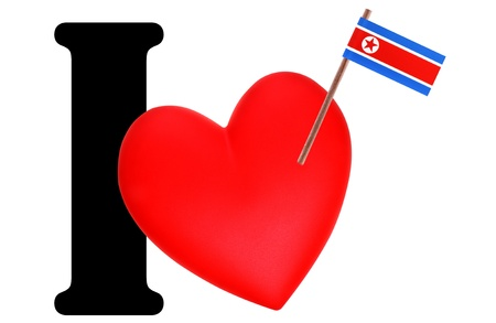 Small flag on a red heart and the word I to express love for the national flag of North Korea photo