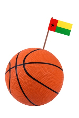 Volley-ball decorated with a small paper national flag of Guinea Bissau on a tooth stick Stock Photo - 14066292