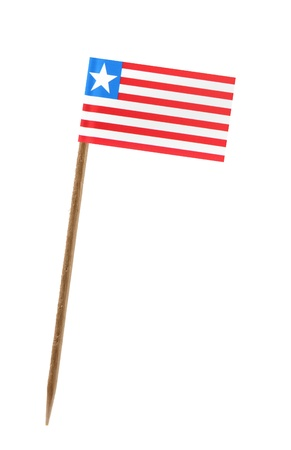Tooth pick wit a small paper flag of Liberia photo