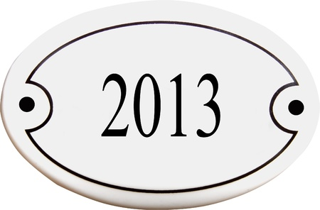 Old fashioned door plate with 2013 on it photo