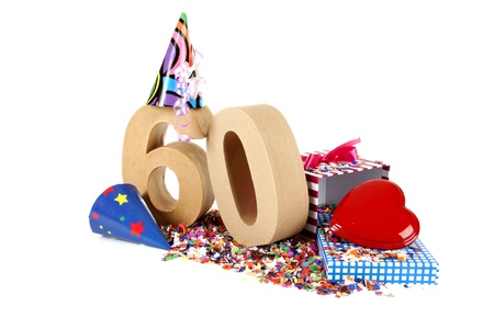 Number of age in a colorful studio setting with paper party hats, a red heart and gifts on a bottom of confettie Stock Photo - 16598413
