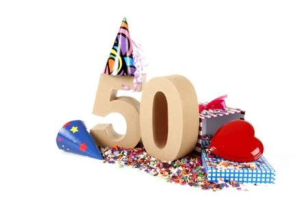 Number of age in a colorful studio setting with paper party hats, a red heart and gifts on a bottom of confettie Stock Photo