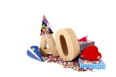age forty: Number of age in a colorful studio setting with paper party hats, a red heart and gifts on a bottom of confettie Stock Photo