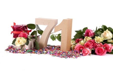 Number of age in a colorful studio setting with fresh roses on a bottom of confetti Stock Photo - 16843707