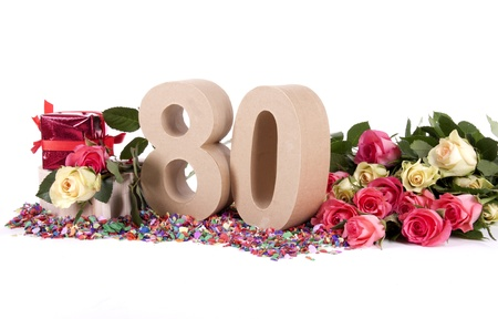 Number of age in a colorful studio setting with fresh roses on a bottom of confetti Stock Photo - 16843758