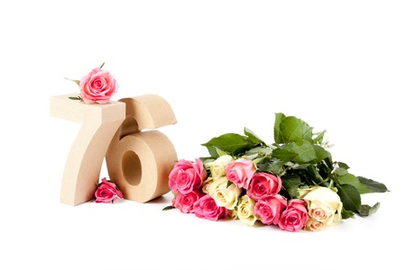 Number of age in a colorful studiosetting,surrounded with roses photo