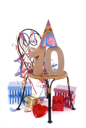 Number of age in a colorful studio setting with paper party hat and figures, a red heart and gifts Stock Photo - 16959654