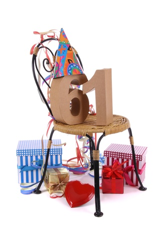 Number of age in a colorful studio setting with paper party hat and figures, a red heart and gifts Stock Photo - 16959687