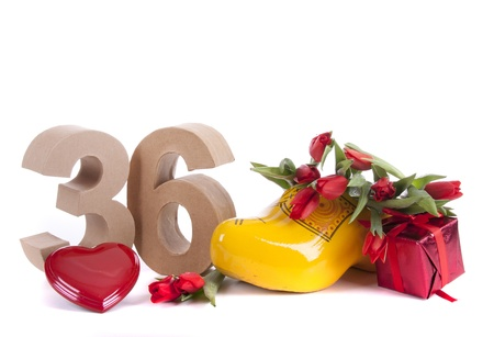 Number of age in a colorful studio setting and Dutch looking attributes like a clog woonden shoe and tulips Stock Photo - 17216422
