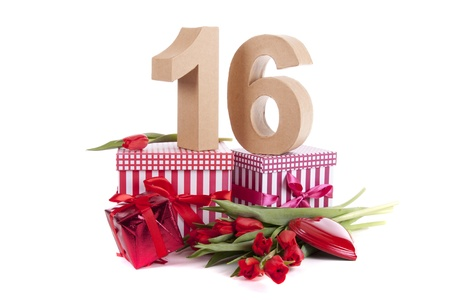 Number of age in a colorful studio setting with a red heart and gifts and tulips photo