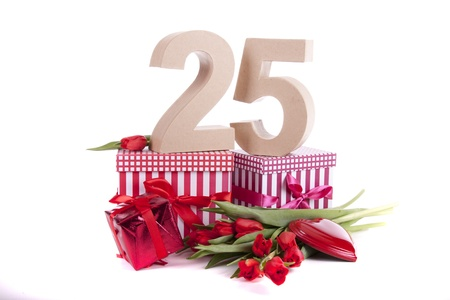 Number of age in a colorful studio setting with a red heart and gifts and tulips